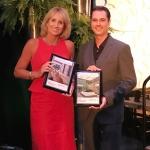 Julie Davis Farrow and ???? receiving Plantinum Award for moss wall design.