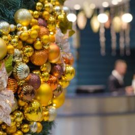 Christmas,Decorations,On,Blue,Modern,Reception,Desk,In,Hotel,On