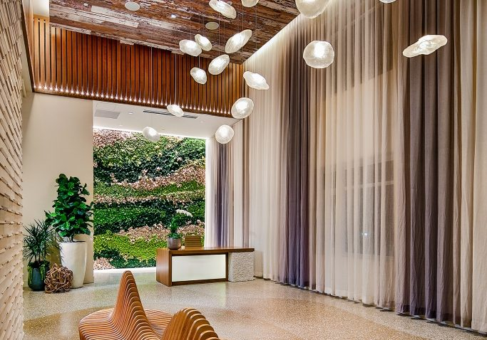 The moss wall is gorgeous addition to The Rey's high-end apartment lobby.